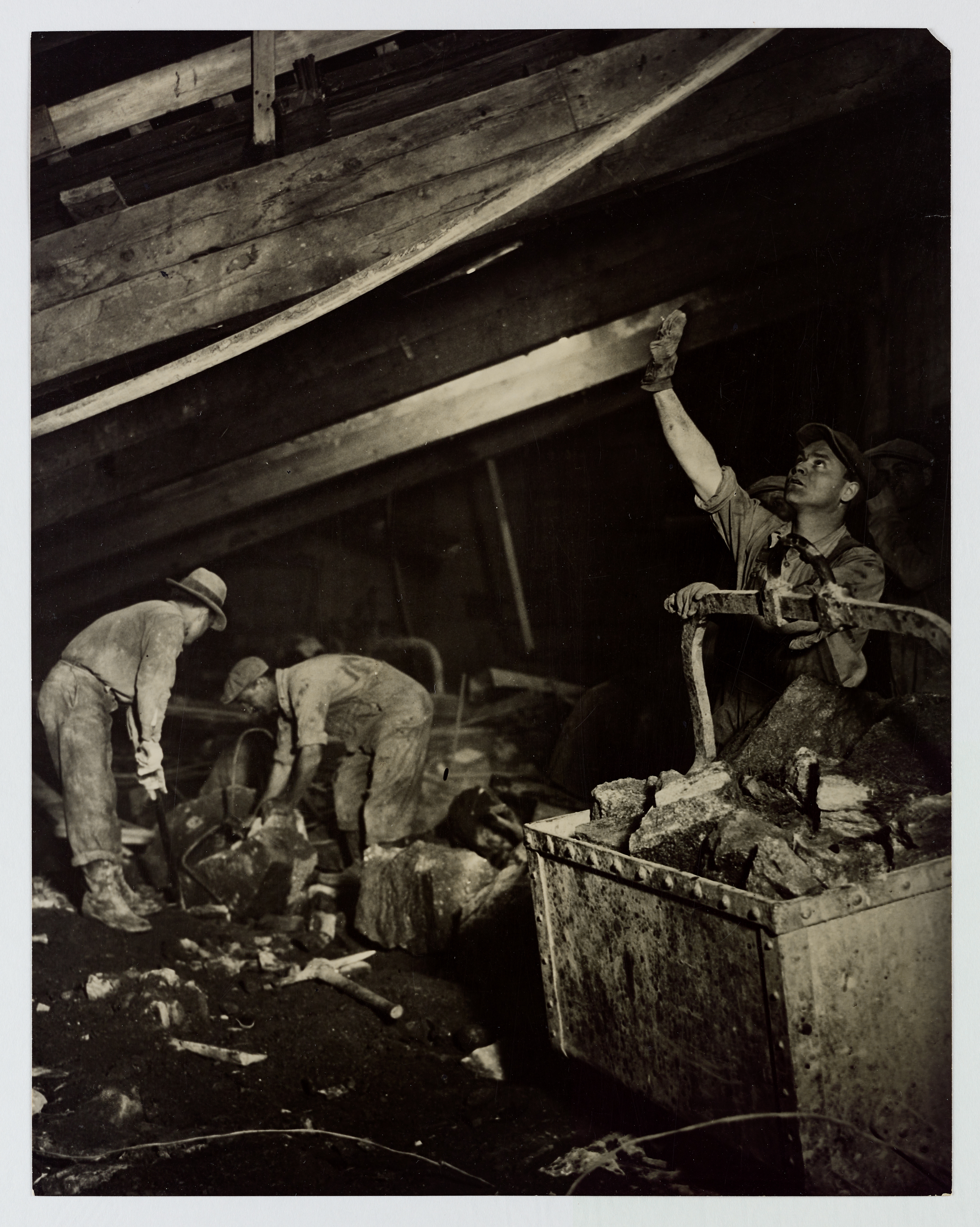 [Construction workers excavating and digging underground, New York City, circa 1920s-1930s].
