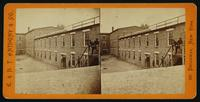Tobacco warehouse on High St. Petersburgh, [sic], Va., used by the rebels as temporary prisons. View from the south side