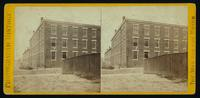 Tobacco warehouse on High St. Petersburgh, [sic], Va., used by the rebels as temporary prisons. Front view