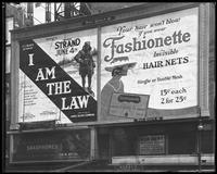 Broadway at 47th Street, New York, May 1922: 'I Am the Law' (motion picture) at the Mark Strand Theatre, Fashionette Hair Nets, C.C. Conn, Ltd., Saxophones.