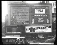 Broadway at 47th Street, New York, May 1922: Buescher True Tone Musical Instruments, 'I Am the Law' (motion picture) at the Mark Strand Theatre, BVD Brand Underwear.