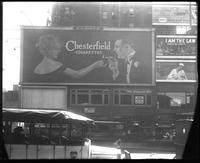42nd Street between Seventh Avenue and Eighth Avenue, New York, May 1922: Chesterfield Cigarettes, 'A Really Good Six' (Jewett Theatre), 'I Am the Law' (motion picture) at the Mark Strand Theatre, Palmolive Soap.