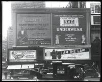 Broadway at 47th Street, New York, May 1922: Buescher True Tone Musical Instruments, 'I Am the Law' (motion picture) at the Mark Strand Theatre, BVD Brand Underwear, Equity California Cafeteria and Restaurant.