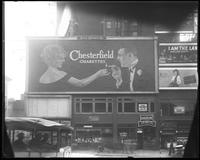 42nd Street between Seventh Avenue and Eighth Avenue, New York, June 1922: Chesterfield Cigarettes, 'A Really Good Six' (Jewett Theatre)(obscured), 'I Am the Law' (motion picture) at the Mark Strand Theatre, Palmolive Soap.