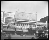 125th Street between Seventh Avenue and Lenox Avenue, New York City, February 24, 1926: Chesterfield Cigarettes, 'The Sea Beast' at the Warner Theatre. C.H. Jennings, Inc. (Dodge Brothers Motor Cars). Also storefronts of Ideal Shoe Shop, Toby's Men's Shop