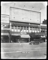 125th Street between Seventh Avenue and Lenox Avenue, New York City, April 28, 1927: Palisades Amusement Park (partial). Also storefronts of Ideal Shoe Shop, Toby's Men's Shop, Christensen School of Rag and Jazz, Orient Photo Plays, Moose Cafeteria (parti
