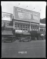 125th Street between Seventh Avenue and Lenox Avenue, New York City, October 31, 1927: Wrigley's Double Mint Gum, 'The Garden of Allah' (motion picture). Also storefronts of Ideal Shoe Shop, Toby's Men's Shop, Christensen School of Rag and Jazz, Orient Ph