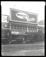 125th Street between Seventh Avenue and Lenox Avenue, New York City, December 30, 1927: Wrigley's Double Mint Gum, 'Love' (motion picture)(partial). Also storefronts of Ideal Shoe Shop, Toby's Men's Shop, Christensen School of Rag and Jazz, Orient Photo P
