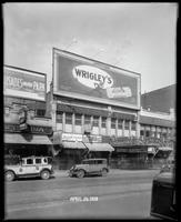 125th Street between Seventh Avenue and Lenox Avenue, New York City, April 26, 1928: Palisades Amusement Park (partial), Wrigley's Double Mint Gum. Also storefronts of Ideal Shoe Shop, Toby's Men's Shop, Christensen School of Music, Orient Photo Plays, Le