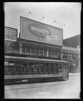 125th Street between Seventh Avenue and Lenox Avenue, New York City, June 28, 1928: Palisades Amusement Park (partial), Wrigley's Double Mint Gum. Also storefronts of Christensen School of Music, Orient Photo Plays (partial), Leight Brothers Outfitting Co