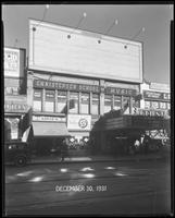 125th Street between Seventh Avenue and Lenox Avenue, New York City, December 30, 1931: 1 empty billboard.  Also storefronts of Tip Top Shoes Shop, Toby's Men's Shop, Christensen School of Music, Orient Photo Plays.