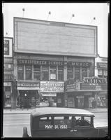 125th Street between Seventh Avenue and Lenox Avenue, New York City, May 31, 1932: 1 empty billboard.  Also storefronts of Tip Top Shoe Shop, Christensen School of Music, Orient Photo Plays.