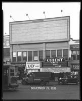 125th Street between Seventh Avenue and Lenox Avenue, New York City, November 29, 1932: 1 empty billboard, Campbell's Tomato Soup (partial).  Also storefronts of Tip Top Shoe Shop, Orient Photo Plays.