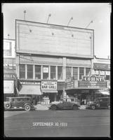 125th Street between Seventh Avenue and Lenox Avenue, New York City, September 30, 1933: 1 empty billboard. Also storefronts of Tip Top Shoe Shop, Orient Photo Plays.