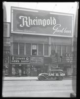 125th Street between Seventh Avenue and Lenox Avenue, New York City, June 30, 1934: Rheingold Beer. Also storefronts of Cameo Men's Shop, Orient Restaurant, Orient Photo Plays (partial).