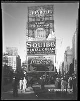 West 47th Street between Broadway and Seventh Avenue, New York City, September 29, 1934: Camel Cigarettes, Chevrolet Cars, Coca-Cola, Howard Clothes (small, distant), Maybelline (partial), Squibb Dental Cream.