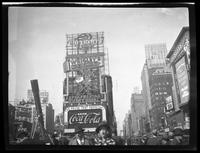 West 47th Street between Broadway and Seventh Avenue, New York City, September 1934: Camel Cigarettes (partial, distant), Chevrolet Cars, Coca-Cola, Wrigley's Spearmint Gum, Maybelline (small, distant).