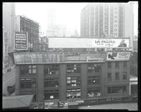Sixth Avenue near 42nd Street, New York City, October 24, 1925: Hotel Times Square, La Palina Cigar, Piedmont Cigarettes, Van-Hart Shoes. Also 2 empty billboards.