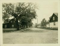 Flatlands: view of Mill Lane looking toward First Methodist Episcopal Church, May 1923. Red shingled house on left (foreground) standing on corner plot of E. 46th Street, belonged to Joseph White (ca. 1857-1860?), then John White, built 1816 and rebuilt 1