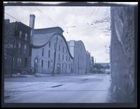 Brooklyn: unidentified armory-style building and large Dutch-roofed building, rear view, undated.