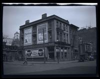 Brooklyn: unidentified building near el tracks, covered in advertisements, undated.