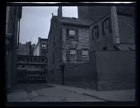 Brooklyn: unidentified brick and wooden houses beside el tracks, undated.