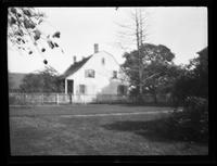 Flatlands: view over a manicured law to an unidentified Dutch-style house, undated. Blurry.