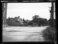 Gravesend: Gravesend Neck Road, looking east from Van Sicklen Street towards Gravesend (now McDonald) Avenue, showing P.S. 95, the Wiltse House, and the Hicks-Platt (Lady Moody) House at 27 Neck Road, [ca. 1920-1930].