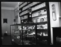 Brooklyn [?]: interior of Lenox Sport Shop, [767 Flatbush Avenue?], undated. Glass display case and light bulbs on shelf.