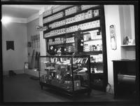 Brooklyn [?]: interior of Lenox Sport Shop, [767 Flatbush Avenue?], undated. Light bulbs, tennis rackets, golf clubs on display.