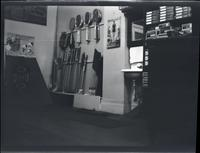 Brooklyn [?]: interior of Lenox Sport Shop, [767 Flatbush Avenue?], undated. Close angle on Radiola advertisement, tennis rackets and golf clubs on display.