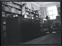 Brooklyn [?]: interior of Lenox Sport Shop, [767 Flatbush Avenue?], undated. Low angle on display cabinets, cash register, multiple fans.