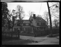Flushing: unidentified wooden house with picket fence, landscaped front garden, undated.