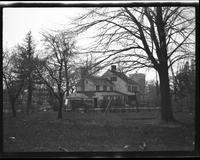 Flushing: unidentified wooden house with picket fence, landscaped front garden, undated. Rear view.
