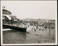 New York City: Coney Island beach with bathers, 1906. Balmer's Bath House visible.