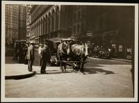 New York City: horse drawn coal truck with broken wheel in front of the New York Produce Exchange at 2 Broadway, undated.