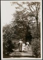 New York City: unidentified woman and two children, Central Park, 1908.