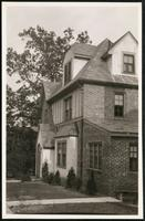 New York City: closer angle on unidentified brick house, undated. Queens.