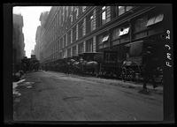 New York City: Siegel Cooper department store at Sixth Avenue and 18th Street, showing horse-drawn delivery wagons, 1907.