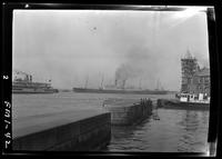 New York City: Battery Park and New York Harbor seawall, steamships visible in harbor beyond, undated.