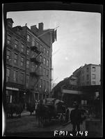 New York City: elevated train, east side, lower Pearl Street, 1906. Horse carts in foreground.