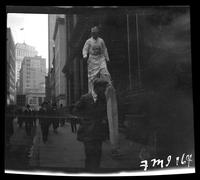 New York City: Mr. Dorie Eddie on stilts, Broadway and Morris Street, undated
