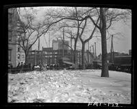 New York City: City Hall Park in snow, undated. Unidentified building under construction visible.
