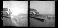 New York City: Coney Island beach with bathers, Balmer's Bathing Pavilion, undated. Stereograph.