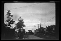 New York City: unidentified houses on dirt road, undated. Queens.