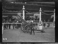 New York City: [unidentified sailor examining captured German artillery piece], undated [ca. 1918].