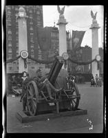 New York City: [soldier seated on captured German artillery piece placed on Park Avenue north of Grand Central Terminal], undated [ca. 1918].