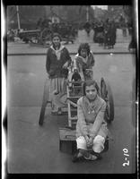 New York City: [three girls with a captured German artillery piece placed on Park Avenue north of Grand Central Terminal], undated [ca. 1918].