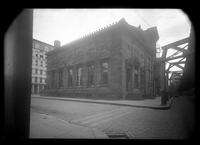 Brooklyn: unidentified two-story brick/stone building beside elevated rail tracks, undated.