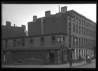 Brooklyn: old two-story brick building on an unidentified corner of Henry Street, undated.